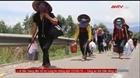 Công an trực chốt hỗ trợ người dân trên đường về quê